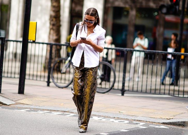 woman wearing snake print pants
