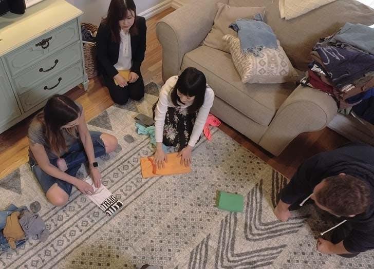 Family folding clothes together KonMari method