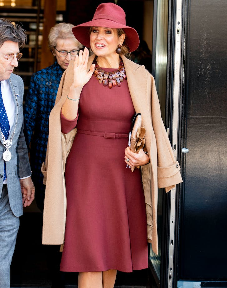 Queen maxima in rust colored dress
