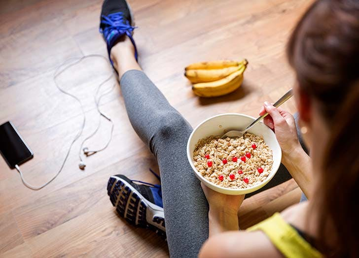 Woman eating cereal post workout