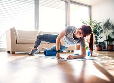 Woman foam rolling her leg 400
