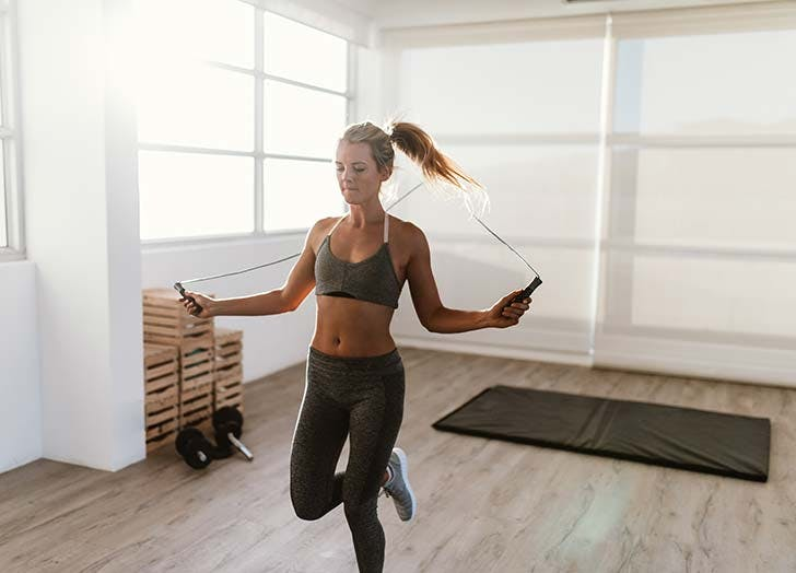 Woman working out jumping jump rope