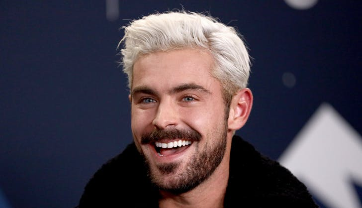 Zac Efron looking very excited about having blonde hair