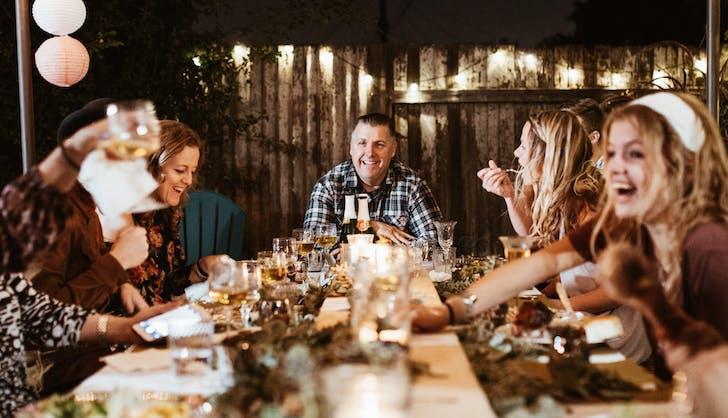 a large group eating dinner together