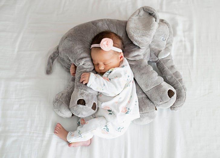 baby clutching elephant