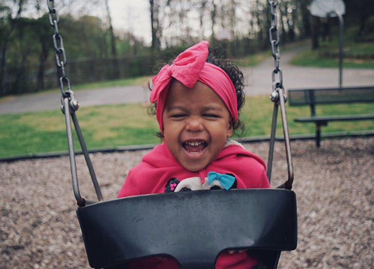 baby on swingset