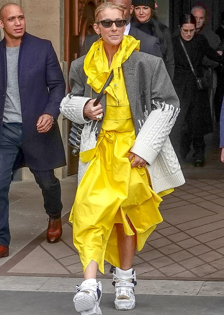 celine dion wearing a yellow dress
