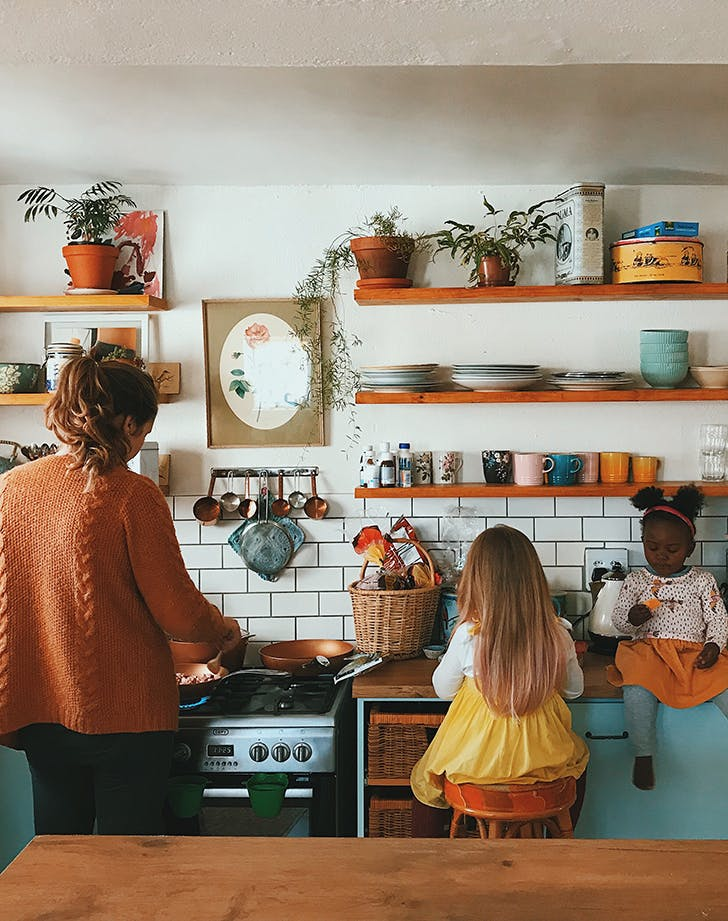 family cooking in vintage kitchen