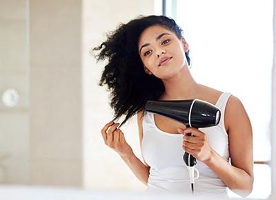 girl blow drying hair 400