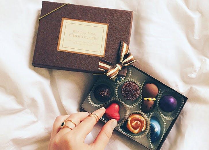hand picking up chocolate