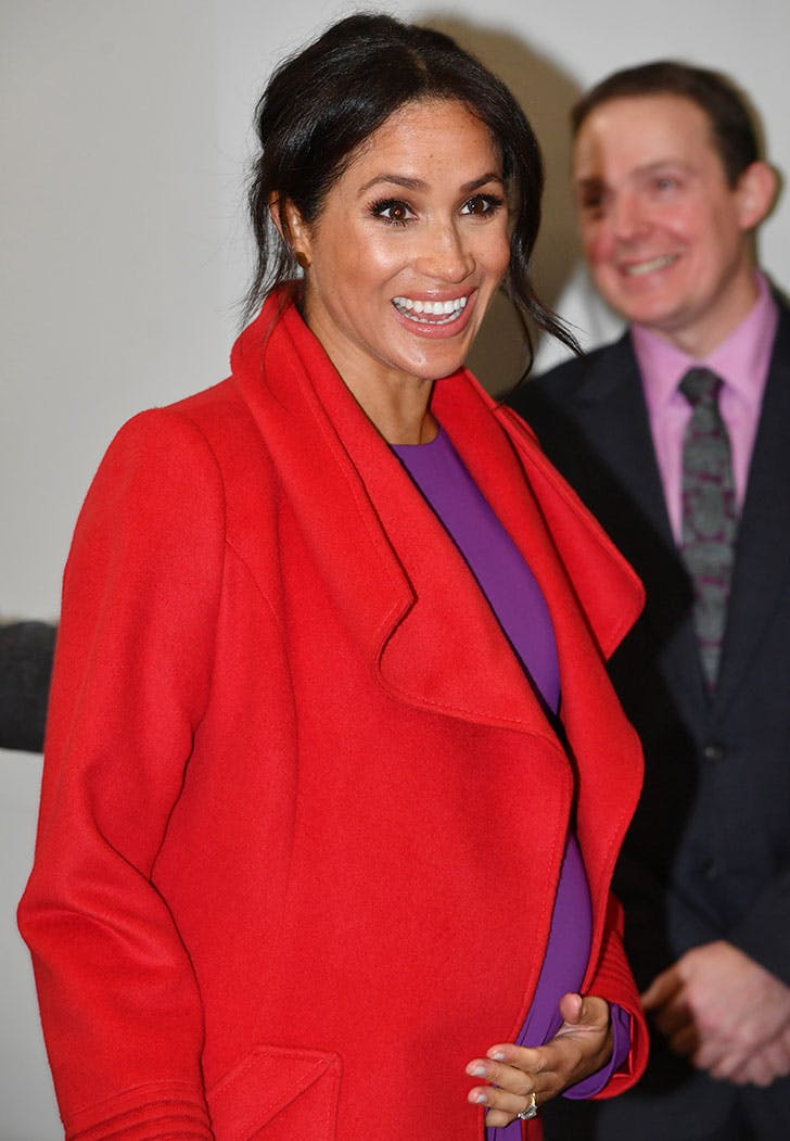 meghan markle laughing baby bump