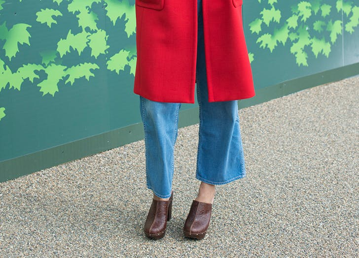 woman in a shearling clog