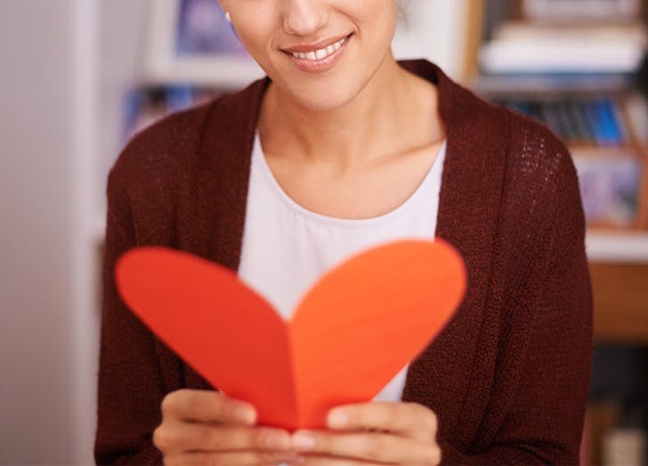 woman reading valentines card