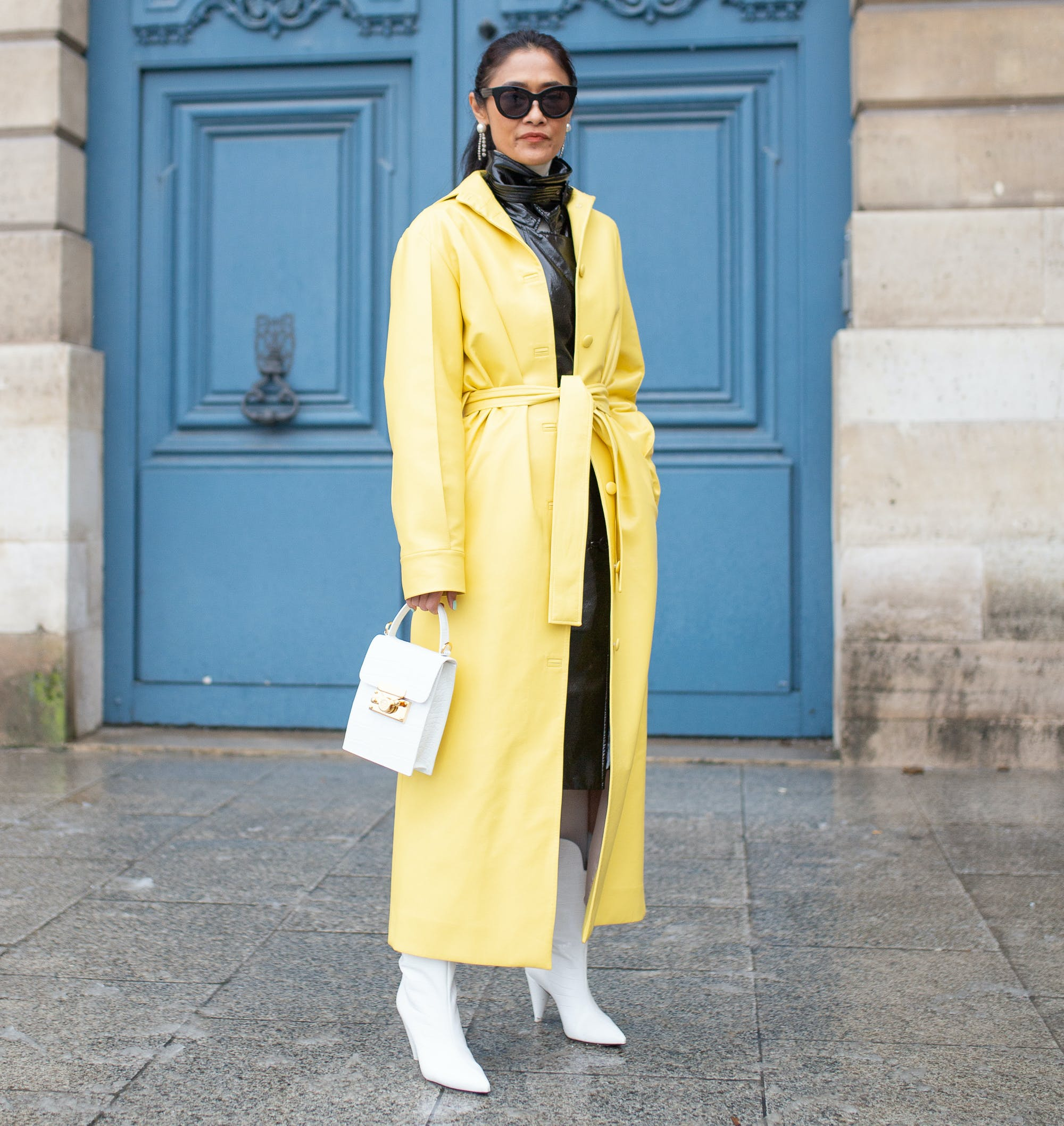 woman wearing a bright yellow coat with white accessories
