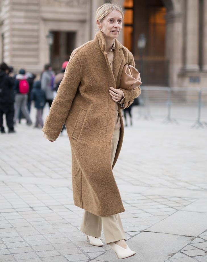 woman wearing a classic camel coat