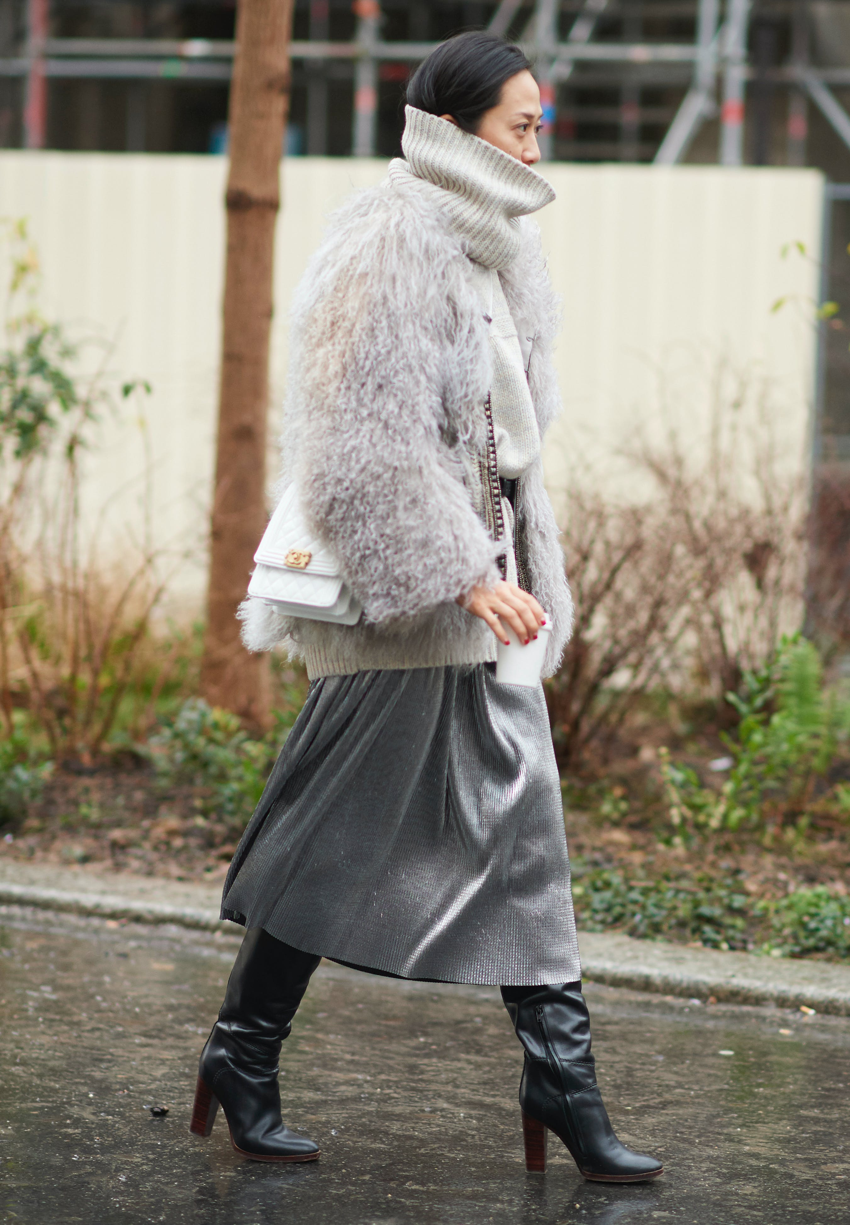 woman wearing a fauc fur coat and silky skirt