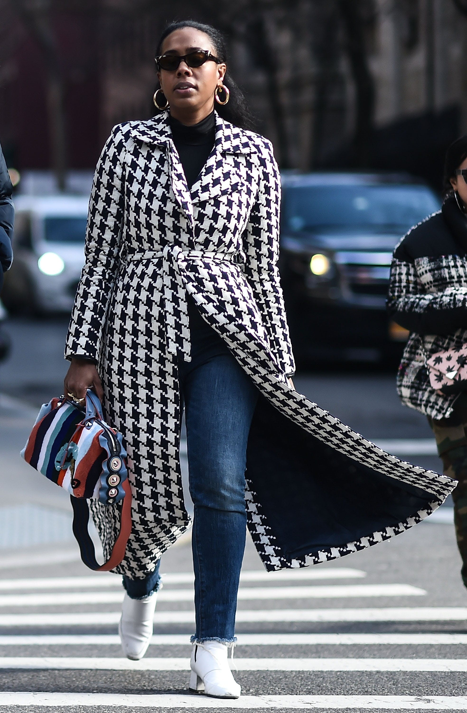 woman wearing a houndstooth coat