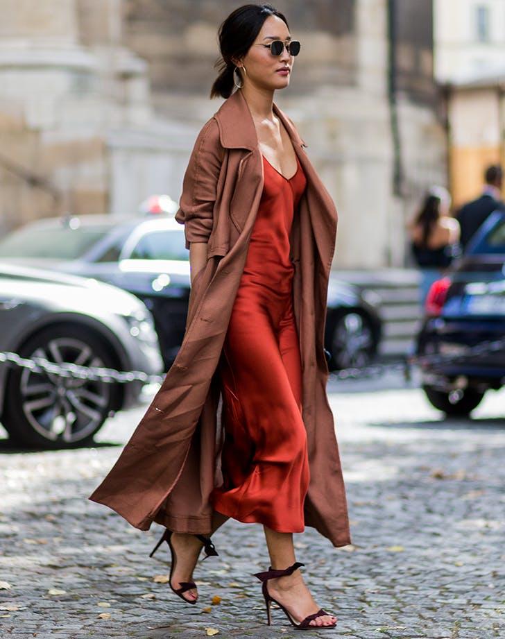 woman wearing a red slip dress