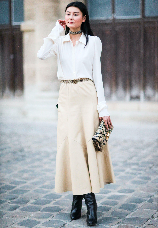 woman wearing a white buttondown shirt