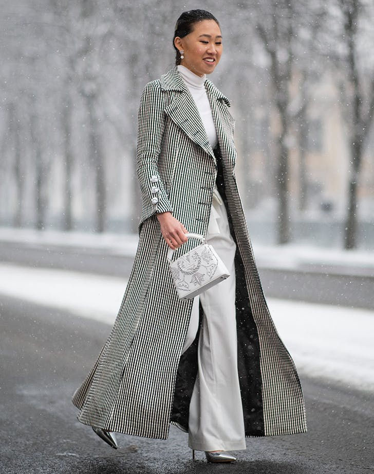 woman wearing all winter white and a checked coat1