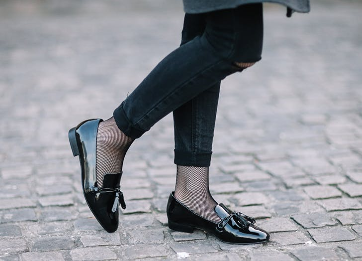woman wearing black leather loafers