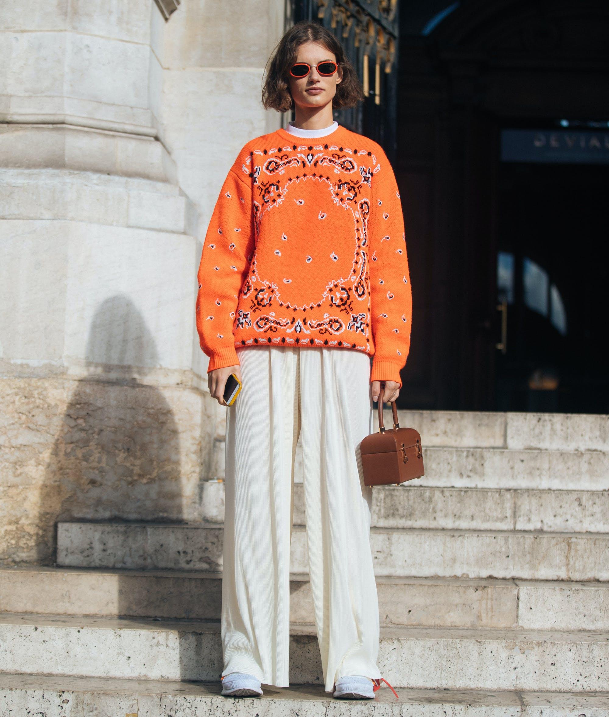 woman wearing neon orange and winter white