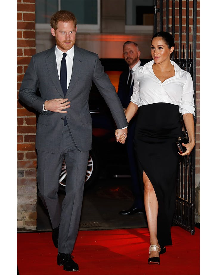 Meghan Markle in thigh high slit with Prince Harry