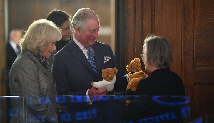 Prince Charles looking at teddy bears
