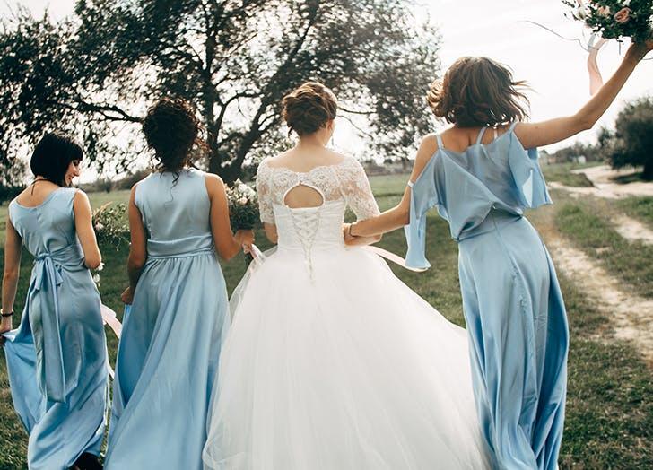 bride with bridesmaids blue