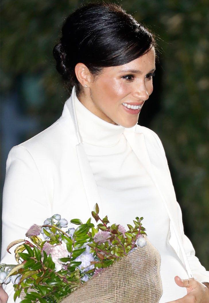 meghan markle smiling flowers