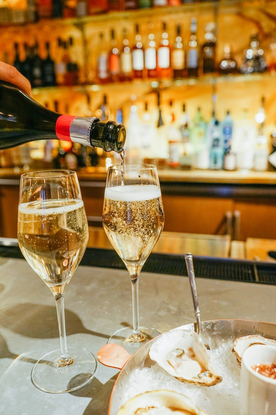 the ivy hotel pouring champagne