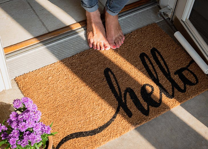 woman standing at welcome mat