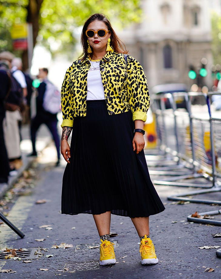woman wearing a midi skirt and cropped jacket