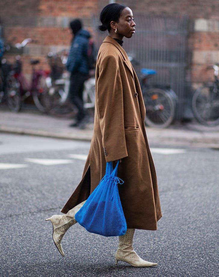 woman carrying a cobalt blue bag