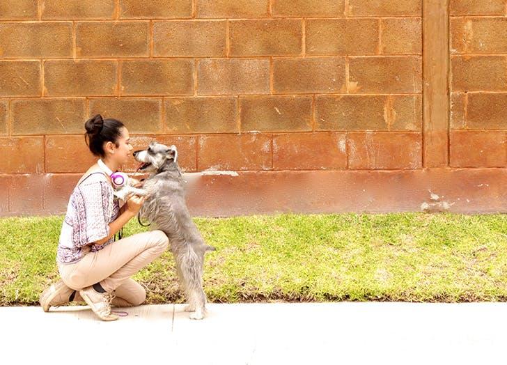 woman hugging dog outside