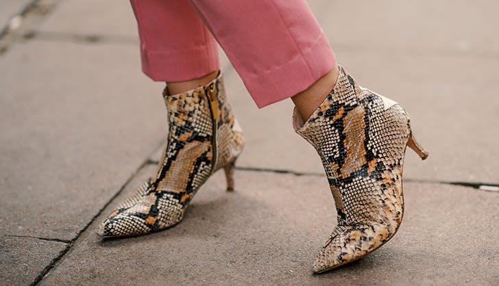 woman wearing snake skin boots