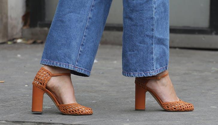 woman wearing woven heels