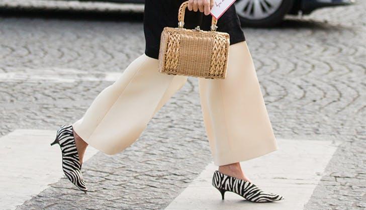 woman wearing zebra print shoes
