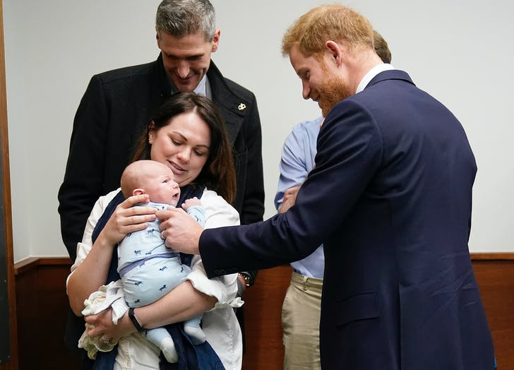 Prince Harry meeting a baby