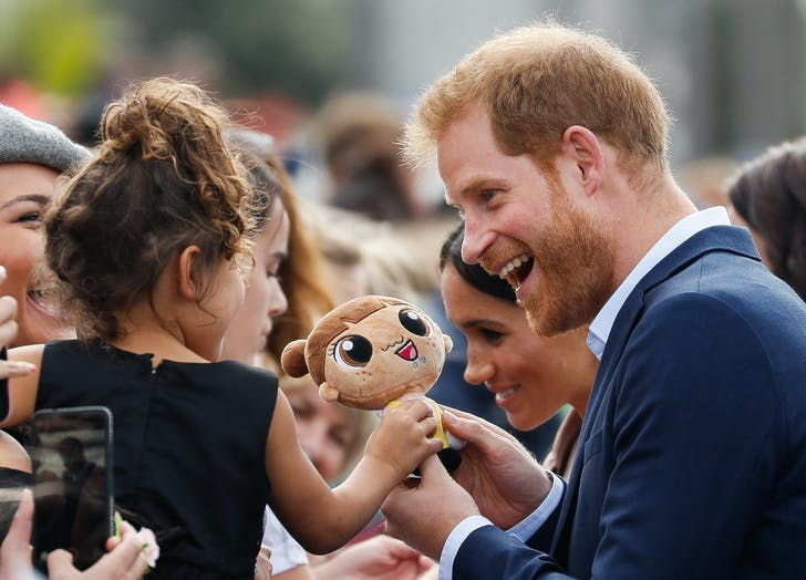 Prince Harry talking to a child1