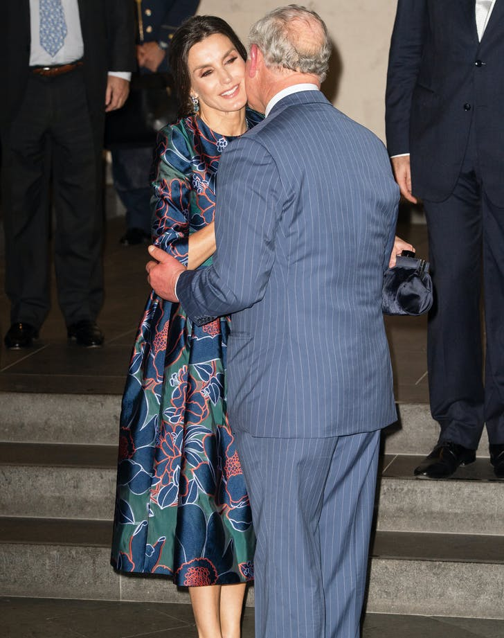 Queen Letizia and Prince Charles kiss