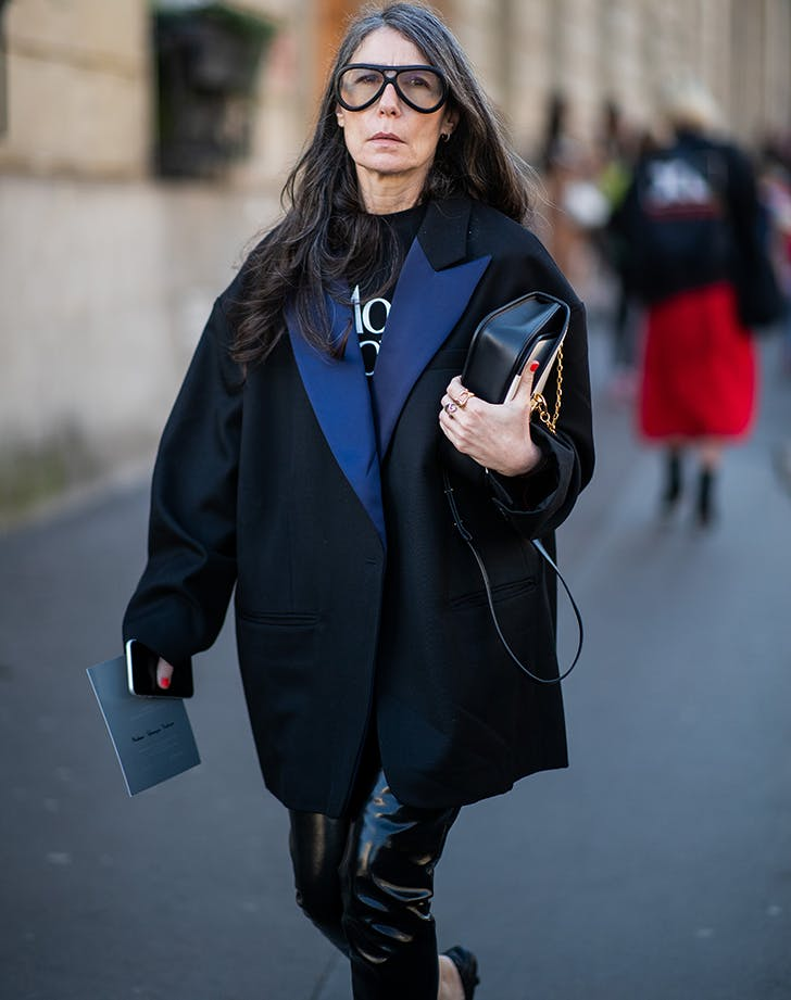 a woman wearing a black and navy coat
