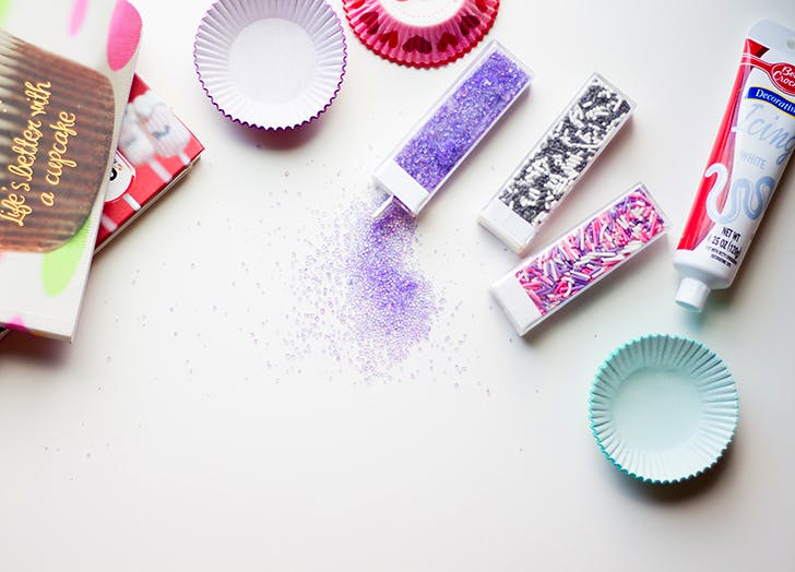 purple pink sprinkles baking cups on counter