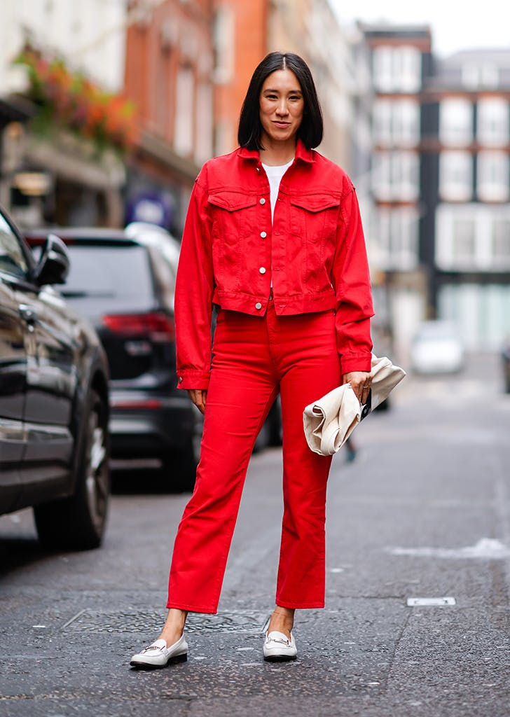woman wearing red jeans and a red jacket