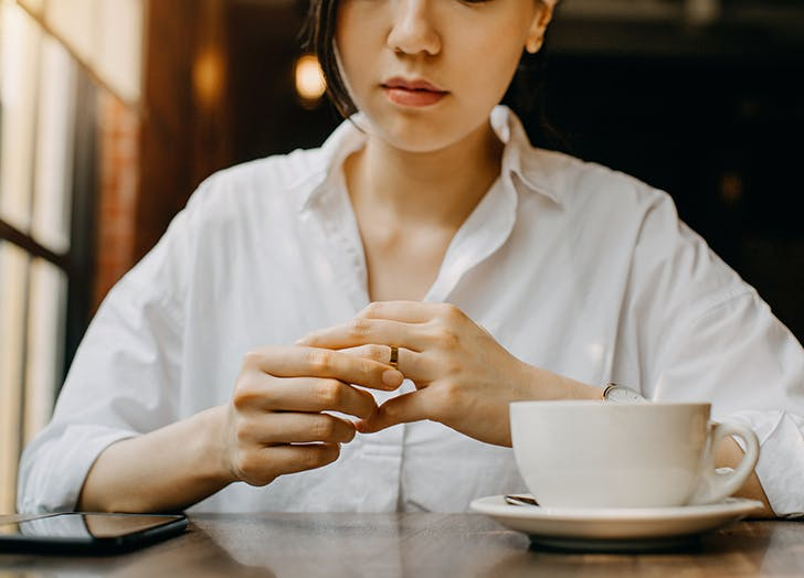 woman touching wedding ring