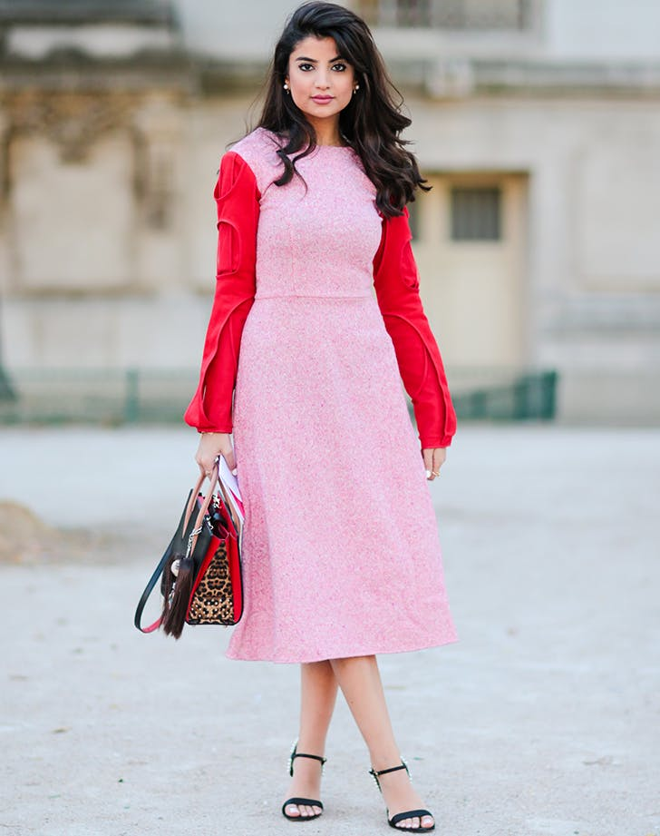 woman wearing a pink dress with red sleeves