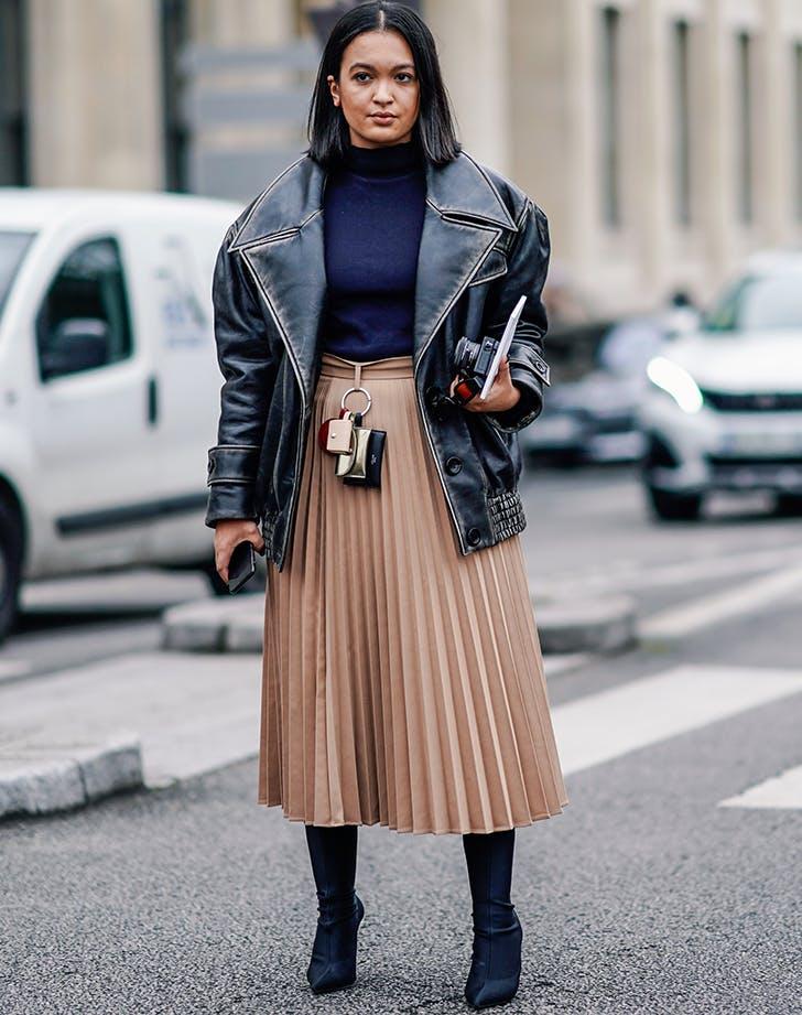 woman wearing navy black and tan