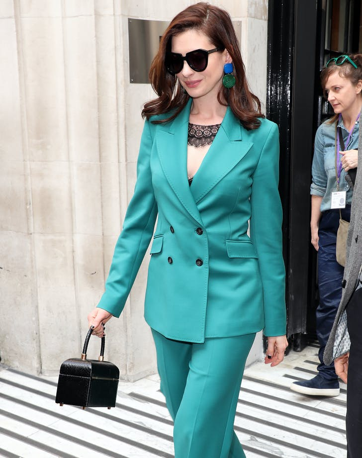 Anne Hathaway in teal suit