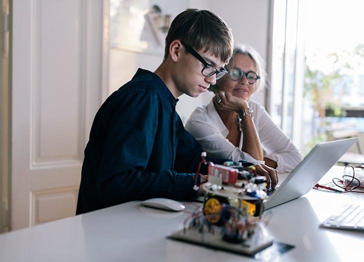 Mom and teenage son on computer1