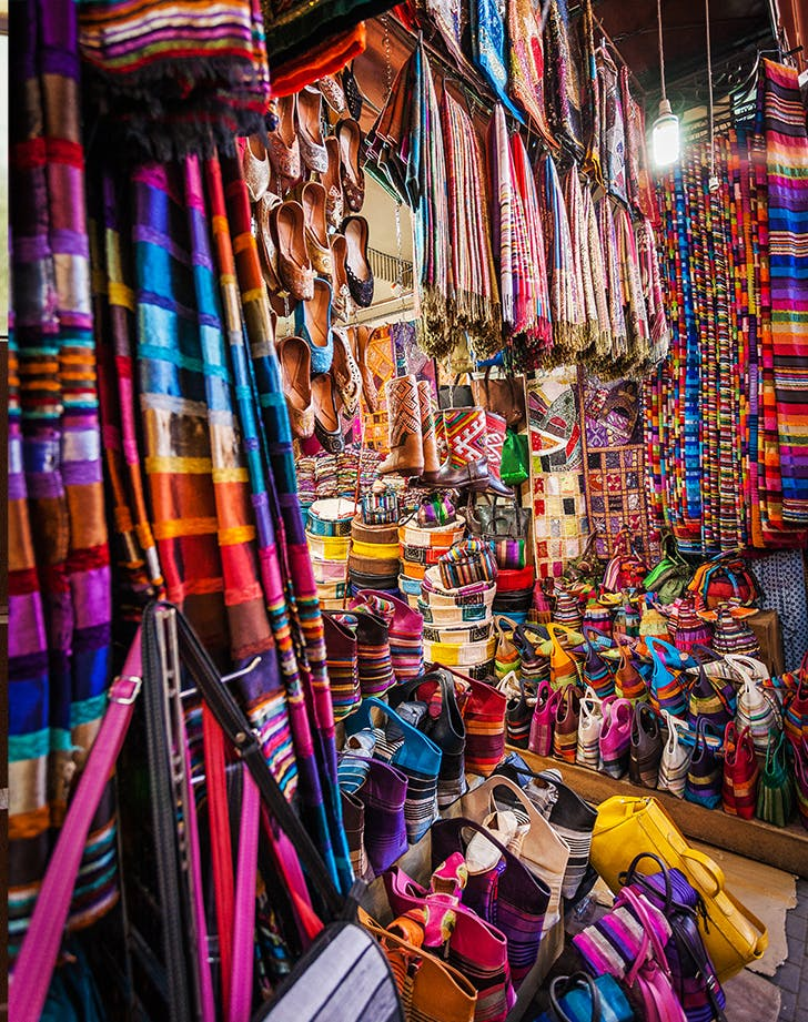 a marketplace full of multicolor fabrics